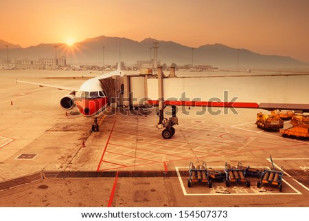 airplane stop at the airport - stock photo