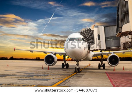 Airplane stop for support service and transfer passenger with twilight time   - stock photo