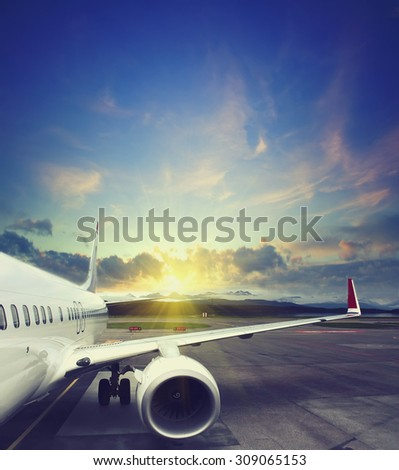 airplane taking off from the airport. fragment of the body of aircraft. business travel concept vintage style picture - stock photo