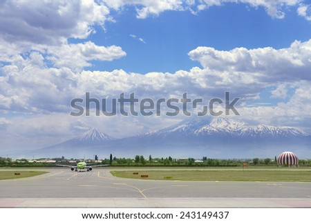 Airplane taxiing on airfield - stock photo