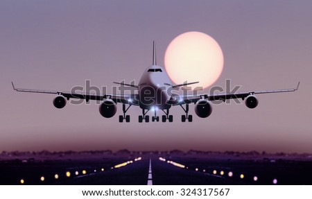 Airplane touch down during sunset - stock photo