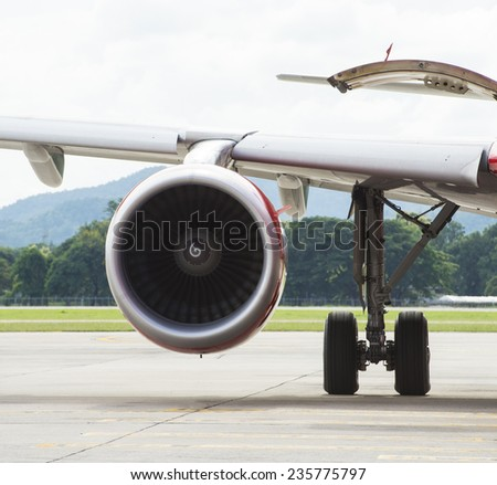 Airplane turbine on the wings of an commercial airplane - stock photo