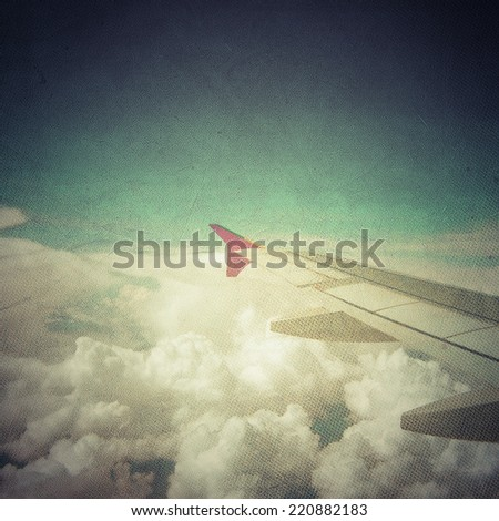Airplane view above the clouds - stock photo