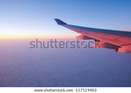 Airplane Wing in Flight from window - stock photo