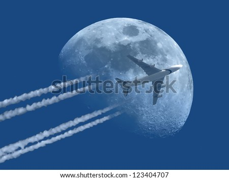 Airplane with Moon in background - stock photo