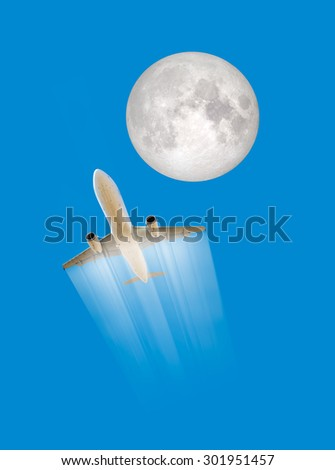 "Airplane with Moon on a clear blue sky in background, composite ""Elements of this image furnished by NASA "" - stock photo"