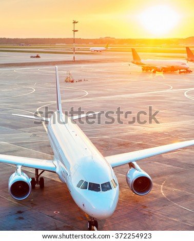 Airplanes in the airport at sunset. View from above - stock photo