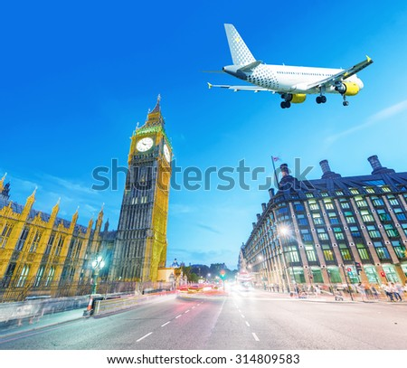 Airplanes in the sky over Westminster at night, London. - stock photo