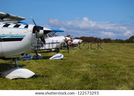 Airplanes lined up in a field - stock photo