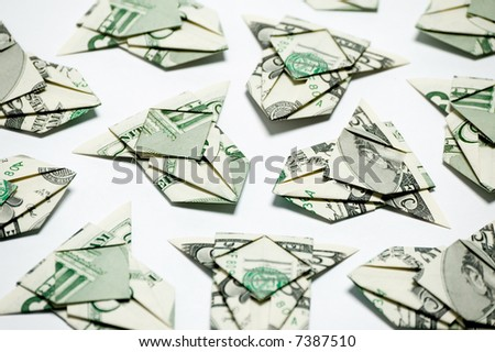 airplanes made with some 5 dollar bills - stock photo