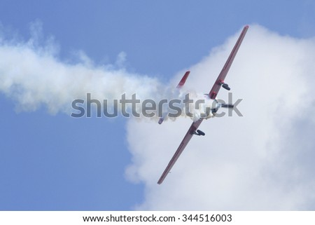 Airplanes On Airshow. Aerobatic team performs flight at air show - stock photo