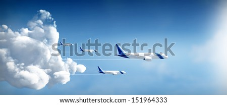 Airplanes travel in different destinations in widescreen side view - stock photo