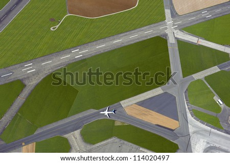Airport - aerial view with runways, taxis, grass and air-crafts - stock photo