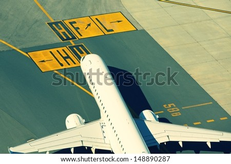 Airport - Airplane is taxiing for take off. - stock photo