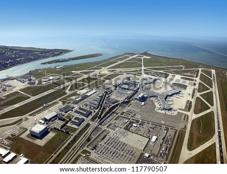 Airport and runways - Vancouver International Airport in Richmond - panoramic aerial view with runways, Fraser River and Pacific Ocean - stock photo