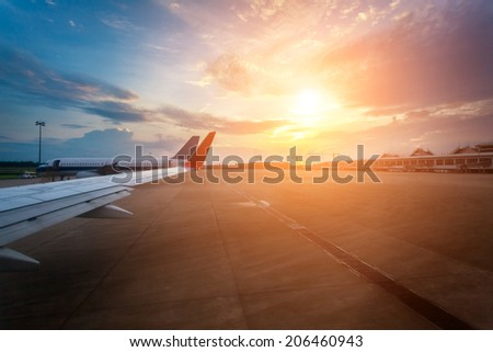 Airport apron sunset - stock photo