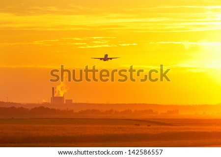 Airport at the sunset - airplane is taking off - stock photo