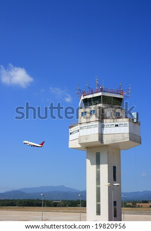 Airport control tower and airplane taking-off - stock photo