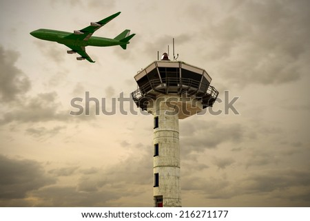 airport control tower at sunset - stock photo