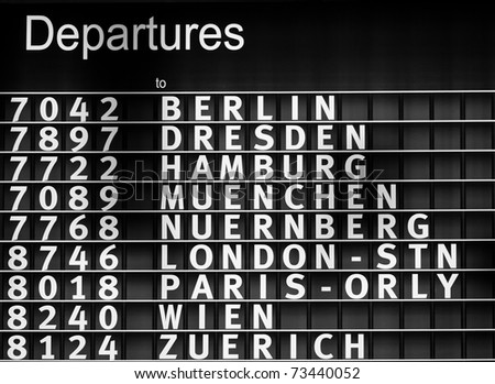 Airport departures information board - air travel background - stock photo