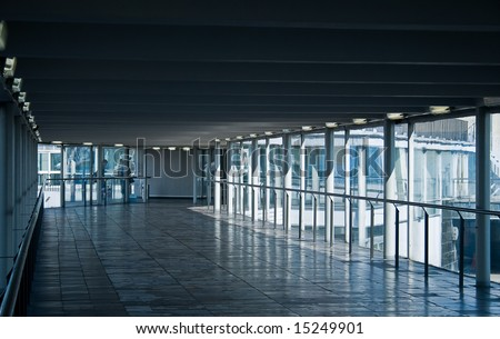 Airport glass corridor on a sunny day. - stock photo