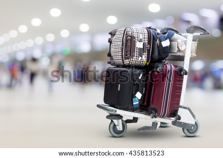 Airport luggage Trolley with suitcases  - stock photo