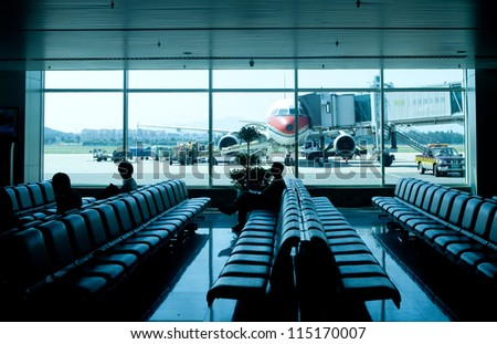 airport outside the window ,waiting for the flight - stock photo