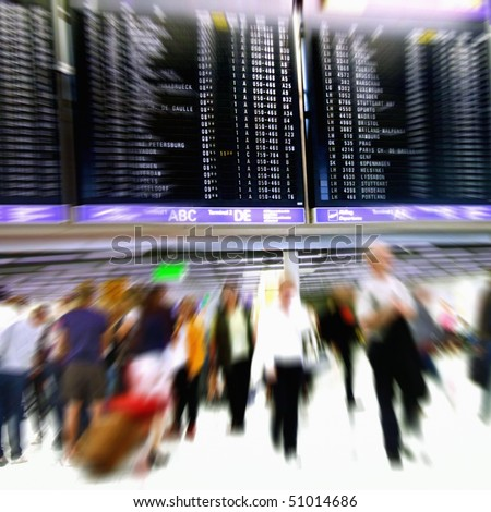 Airport passengers in a departure terminal in front of an schedule display - Motion Blur - - stock photo