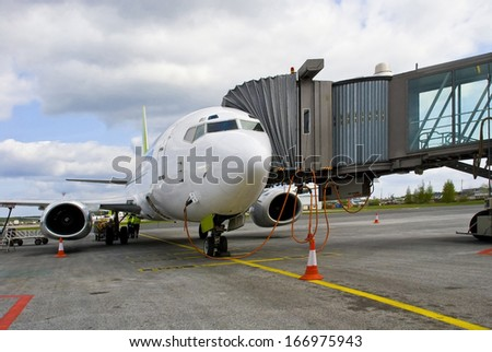 Airport. Preparation of the airplane for flight. - stock photo