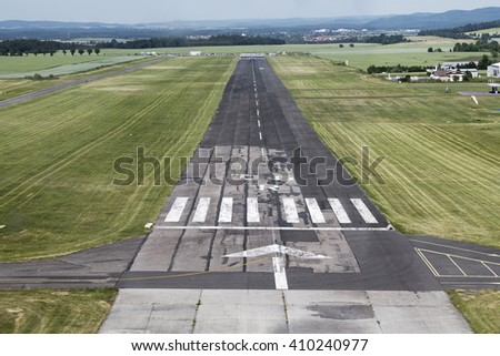 Airport runway with marking - stock photo