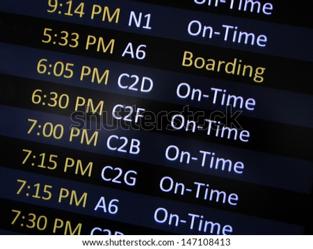 Airport signage alerting passengers to board airplane. - stock photo