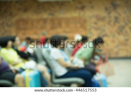 airport terminal blurred crowd of travelling people on the background. - stock photo