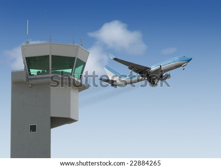 Airport tower with jet taking off in the background - stock photo