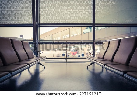 airport waiting area , seats and outside the window scene  - stock photo