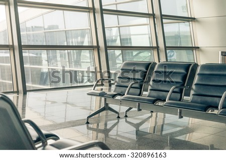 airport waiting area, seats and outside the window scene - stock photo