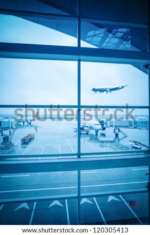 airport window outside scene in the rain weather - stock photo