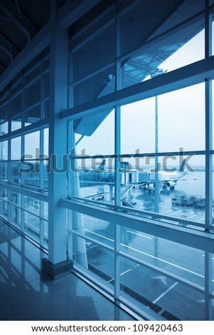 airport window outside with blue tone - stock photo
