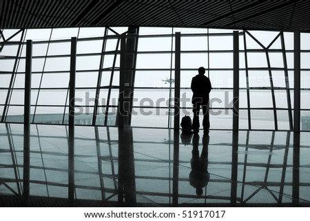 Airport windows, people on the back - stock photo
