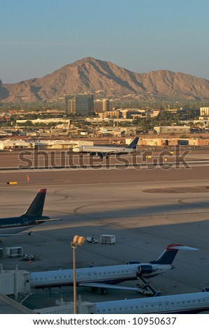 Airport with landing plane. - stock photo