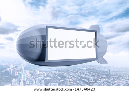 airship with poster over city - stock photo