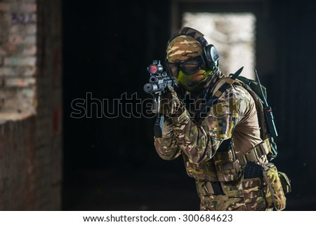 airsoft soldier with a rifle playing strikeball - stock photo