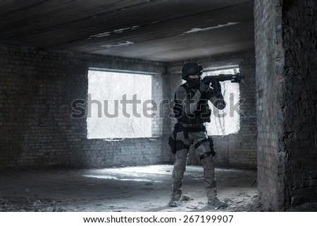 Airsoft strikeball player in military soilder uniform in action - stock photo