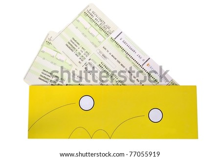 Airtickets to yellow envelope on white background - stock photo