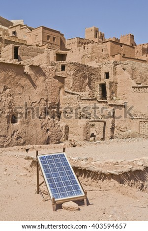 Ait Benhaddou solar panel placed over adobe roof - stock photo