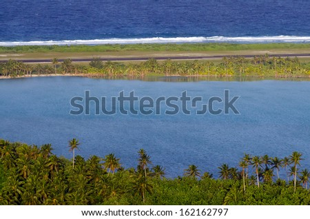 """AITUTAKI - SEP 16:Aerial view of small tropical island in Aitutaki Lagoon, Cook Islands on Sep 16 2013. Air Rarotonga altered the flight path of its planes during the of filming of """"Survivor"""" TV show. - stock photo"""
