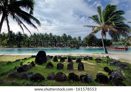 AITUTAKI - SEP 20: Te-Poaki-O-Rae (the stone of Rae) on Sep 20 2013.It's over 1000 years old built from volcanic rocks arranged in rows facing the main pillar placed on the sunrise side towards east. - stock photo