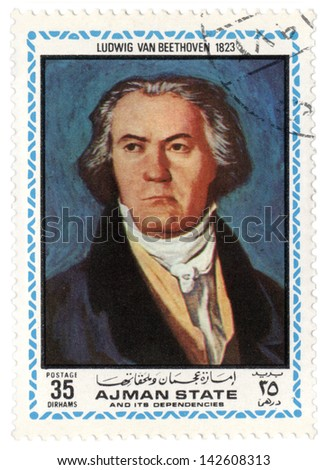AJMAN - CIRCA 1972: A stamp printed in Ajman shows a portrait of German composer Ludwig van Beethoven in 1823, series, circa 1972 - stock photo