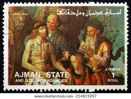 AJMAN - CIRCA 1973: a stamp printed in the Ajman shows The Descent from the Cross, Life of Jesus, circa 1973 - stock photo