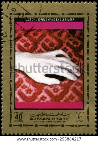 AJMAN STATE - CIRCA 1972: A used postage stamp from Ajman State, featuring an image of a cast of Frederic Chopins hand, circa 1972. - stock photo