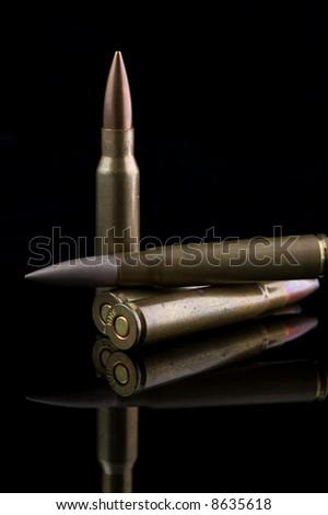 AK47 Rifle Ammunition on Black - stock photo